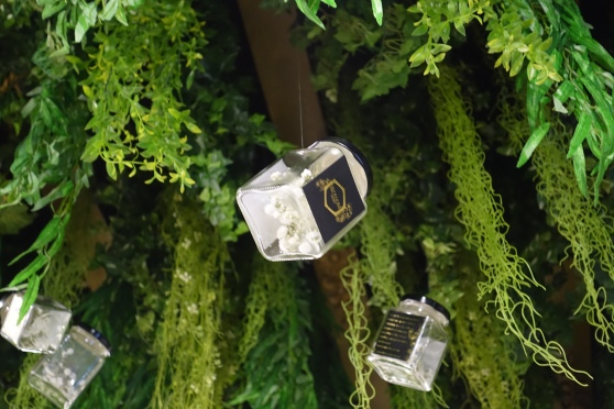 Stunning upside-down garden themed set up. Creatively suspended honey jars from the ceiling.