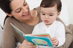 Mother reading with baby son